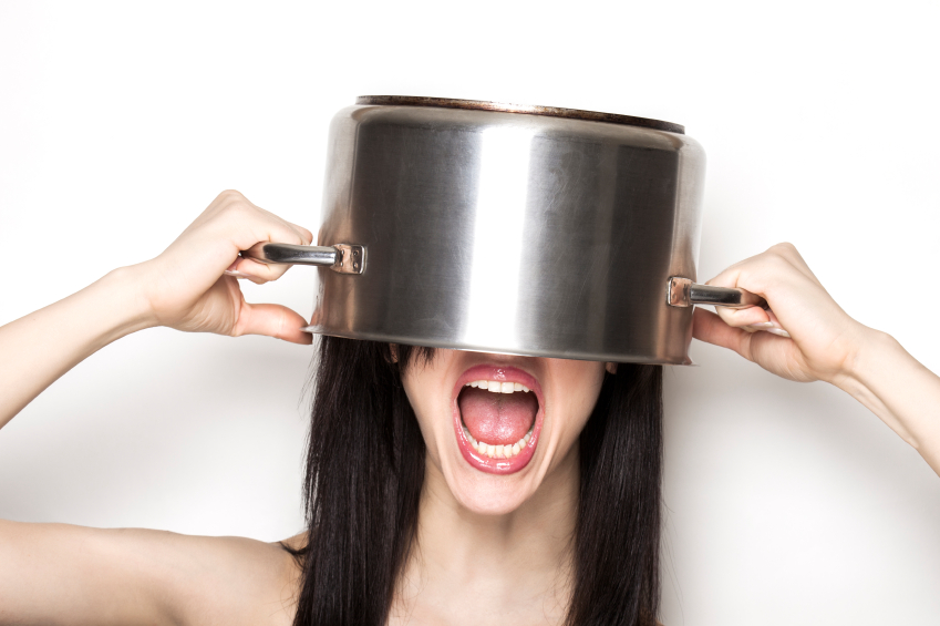 Screaming girl wearing a pot as hat